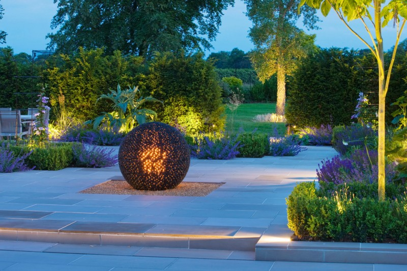 contemporary landscaping idea dark nest with flame inside lighting fixture paving floors