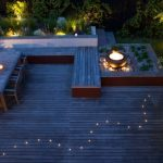 Contemporary Patio Idea Wood Decking Floors Wooden Outdoor Dining Furniture Set Wood Board Benches Low Lighted Lighting Garden Idea