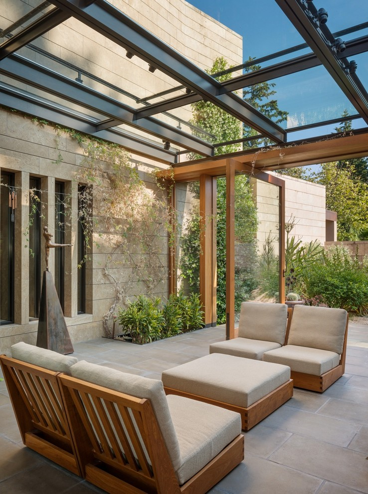 contemporary sunroom double pivoting door contemporary outdoor furniture set glass ceilings with metal supports large paves floorings