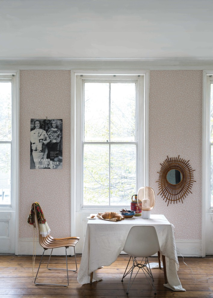 eclectic dining room small dining furniture consisting of white molded plastic chairs modern wood chair with thin metal legs covered table light pink walls wood floors