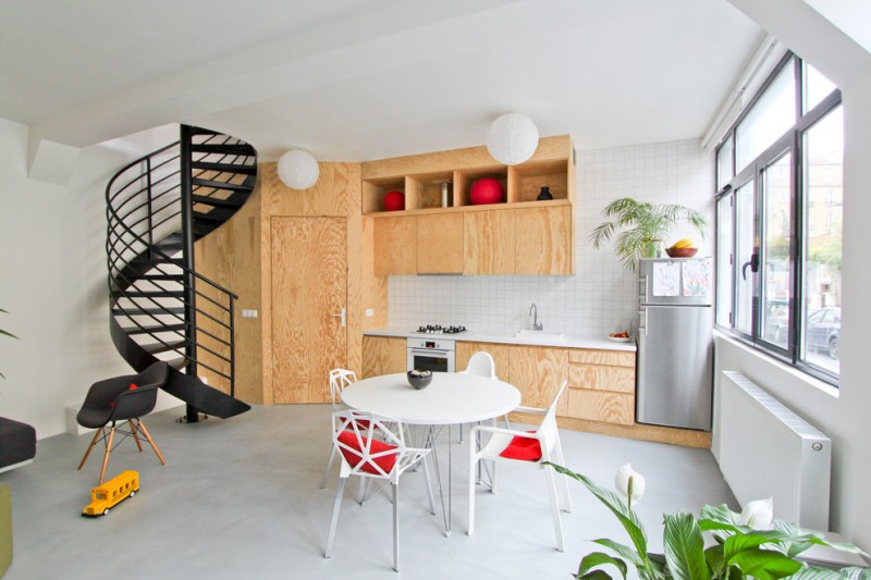 eclectic kitchen idea light toned wood wall integrated with kitchen cabinets white tiles backsplash white round top dining table modern dining chairs arm chairs with Eiffel base in black