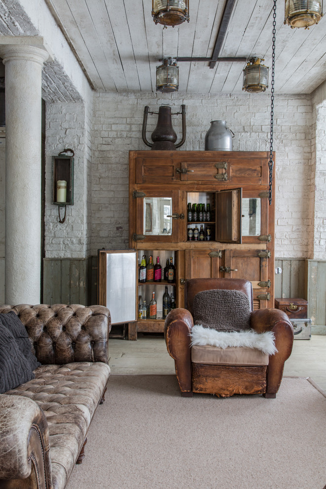 farmhouse bar idea hardwood wine storage rustic vintage chair & sofa in old look rough concrete floors grey bricks wall whitewashed wood board ceilings