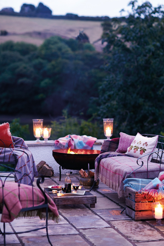 farmhouse decking idea industrial style furniture set throw blankets throw pillows lower leveled center table candles with glass cups paving floors