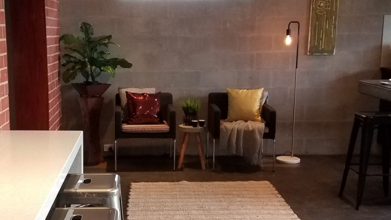 industrial style seating corner idea mid century modern furniture set with vintage touch medium sized area rug in white grey walls concrete flooring idea