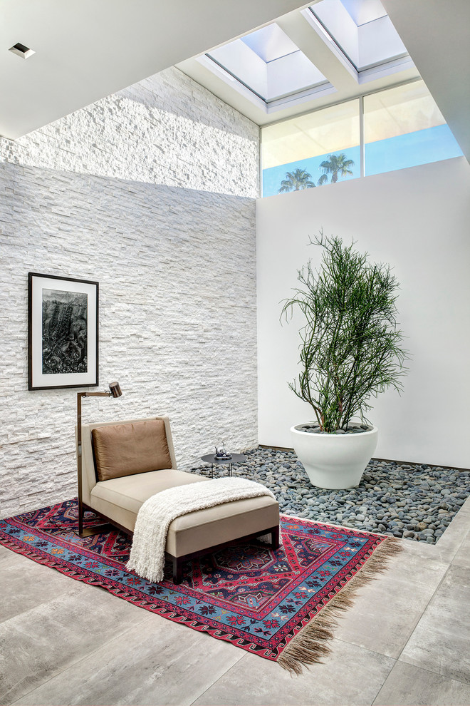 linear soft textured walls in white glass paneled skylight black framed wall decor indoor plant with white concrete planter single daybed modern minimalist stand light fixture Moroccan rug