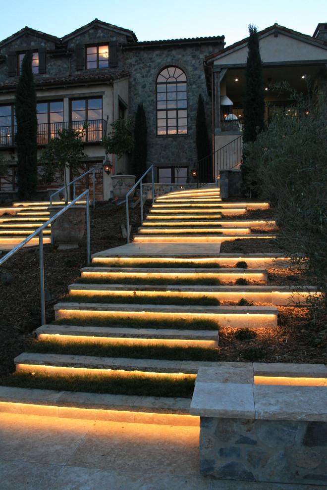 mediterranean landscape idea stone lit steps metal railing system