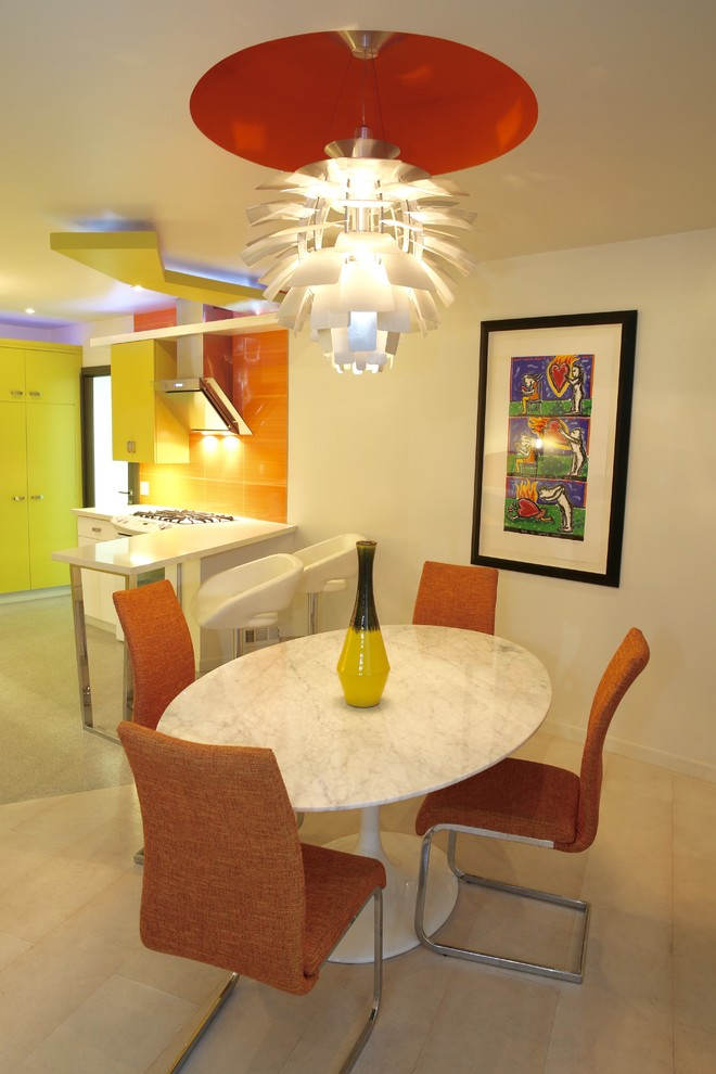 mid century dining room round top marble dining table orange upholstered chairs decorative pendant in white