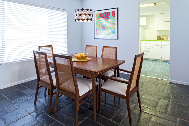 mid century modern dining room baby blue walls black tiles floors wood dining furniture with higher back wood dining table