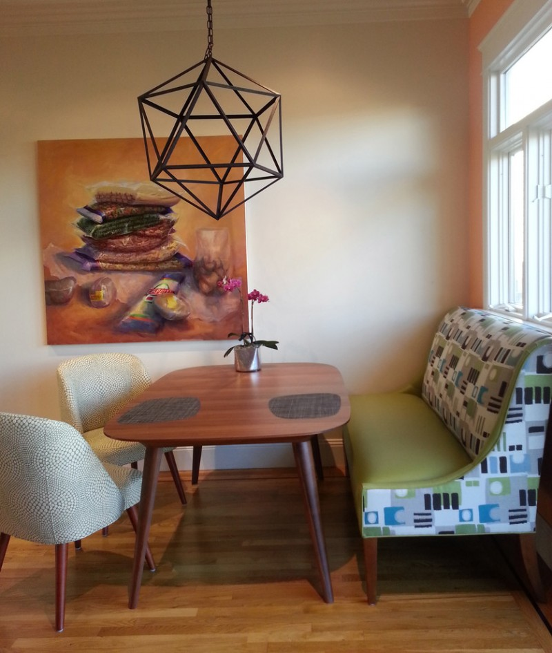 midcentury dining room idea beige painted walls decorative pendant lamp green dining sofa with playful fabric wood dining table medium toned wood floors
