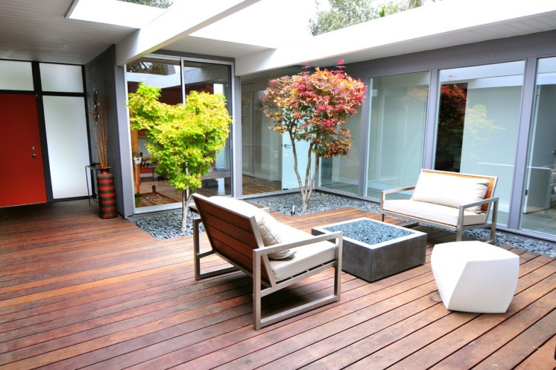 midcentury modern interior landscaping and deck idea midcentury modern seats concrete central firepit in square shape wood decking floors stone landscape floors