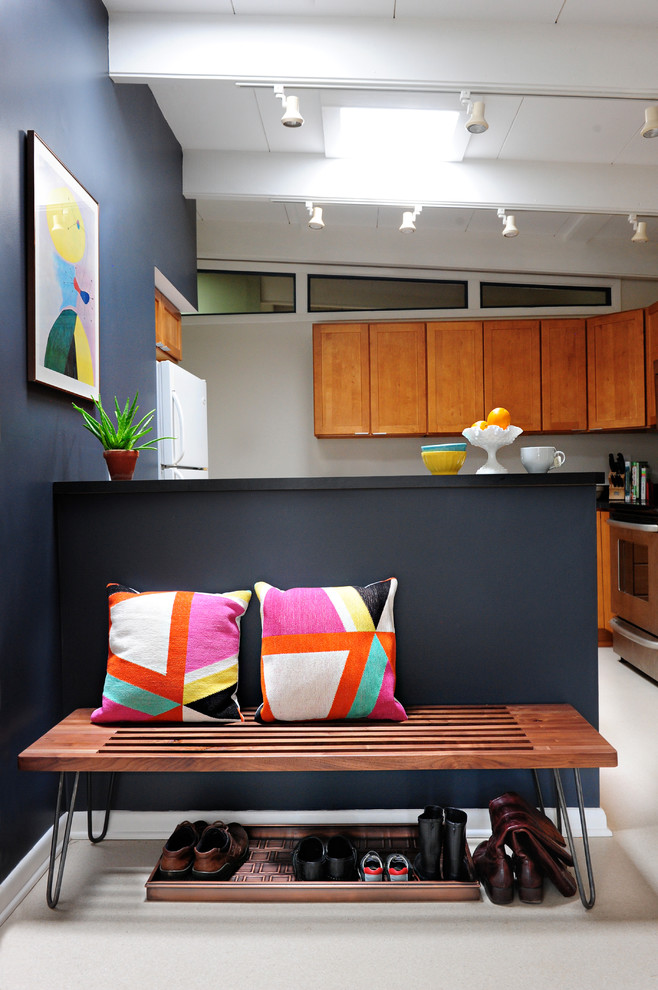 midcentury modern kitchen idea bold grey and light grey interior walls colorful wall decor wood bench with hairpin legs under shoes storage wood upper kitchen cabinets modern spotlight fixtures
