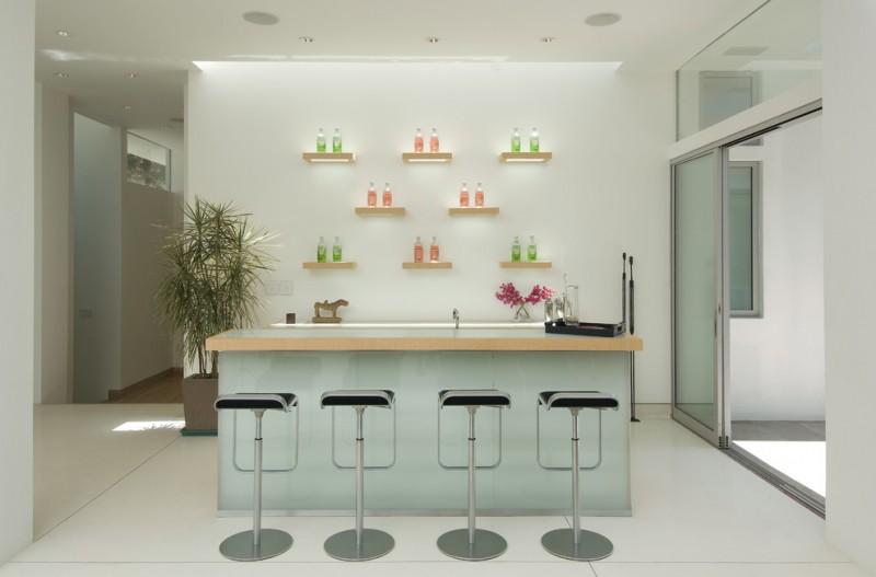 midcentury modern kitchen in soft tone decorative bottle stands modern bar stools soft white walls light blue kitchen island