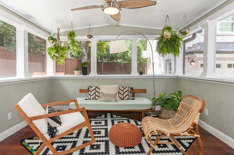 midcentury modern sunroom idea with vertical line accents on walls modern patterned area rug midcentury modern furniture set