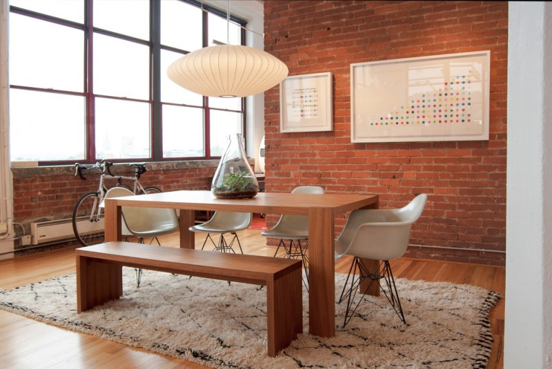 mix mid century modern industrial dining room red bricks walls large wall arts Eiffel tower base chairs in white medium toned wood dining table & bench tribal rug in white