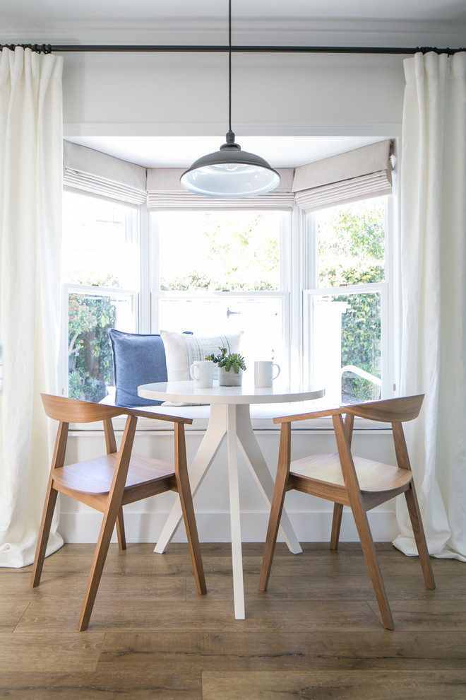 modern farmhouse breakfast nook small wood chairs small bench in white full length curtains in white medium toned wood floors