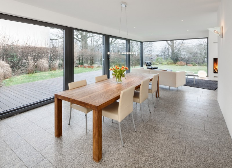 modern line & clean look dining room soft cream dining chairs wood dining table grey tiled floors large glass windows modern silver pendant