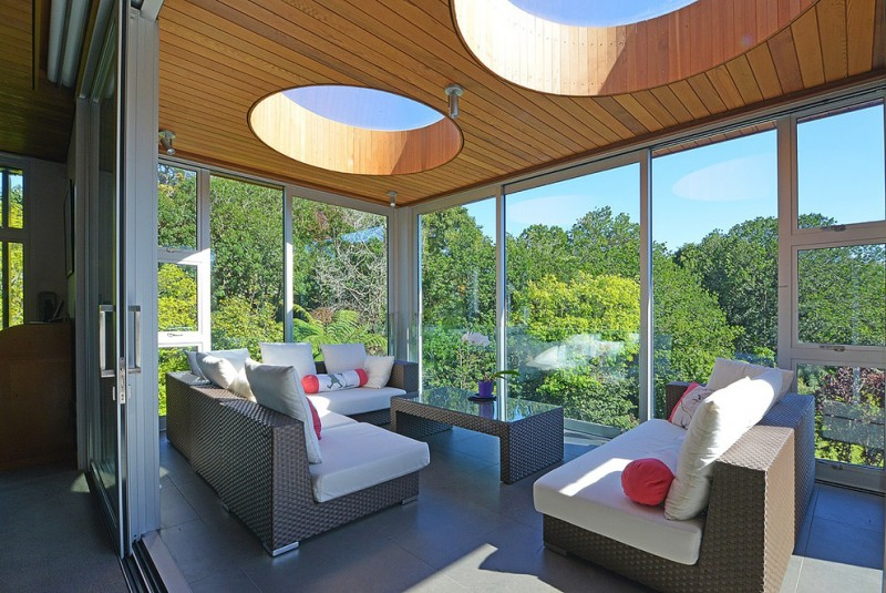 modern sunroom with wood siding ceilings with round skylights