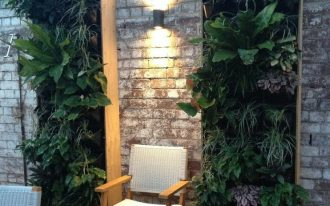 modern wall sconce illuminating a single chair