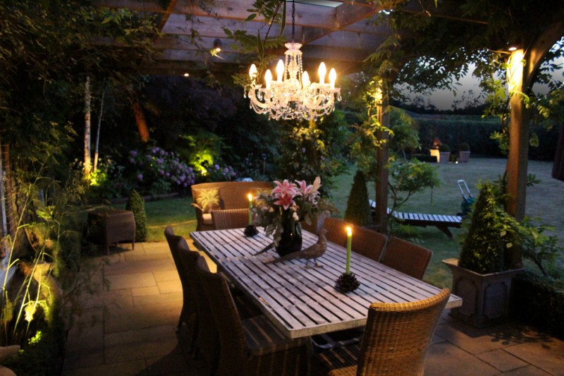 outdoor dining space chandelier garden lighting outdoor dining furniture paving deck floors