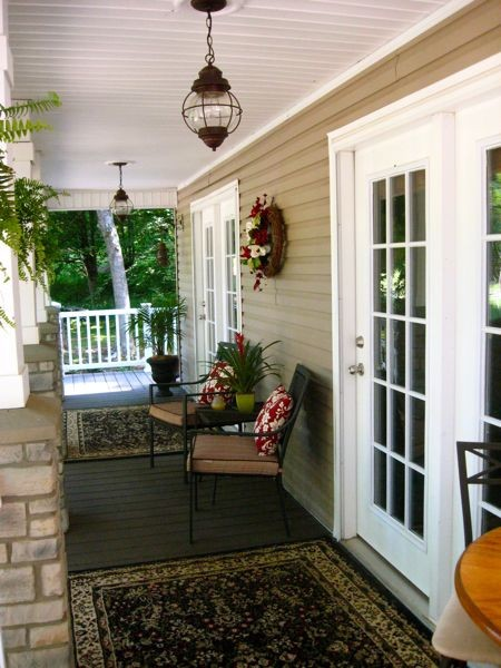 rustic hanging light fixture cream siding exterior walls white painted ceilings dark wood siding floors tuscan carpets