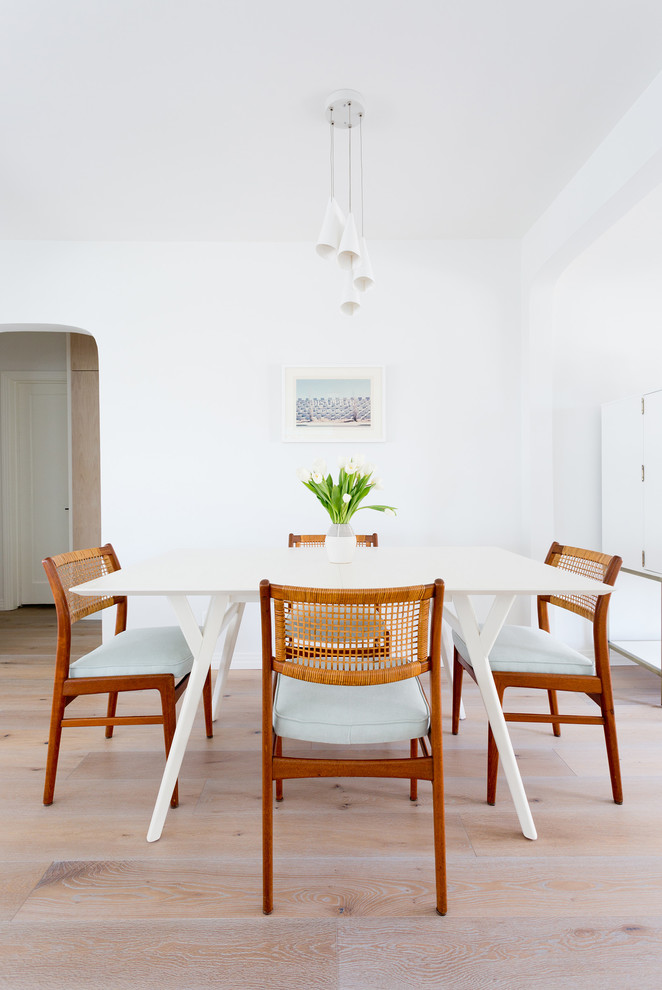 scandinavian style dining room white dining table mid century modern wood dining chairs light toned wood floors white walls