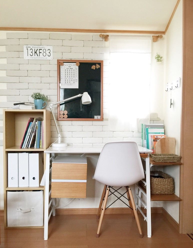 small scandinavian home office white top working table with under storage white molded plastic chair with wood legs vertical book shelve white brick walls accented by wood lines