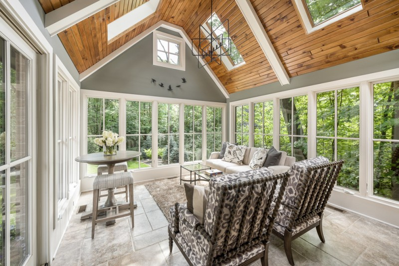 traditional sunroom design oak slanted ceilings with skylights grey sunroom interior