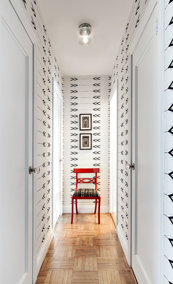transitional hallway creative black white wallpaper shiny red chair parquet tiles wood floors in medium toned finishing ceiling bulb light fixture