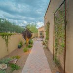 Tuscan Sideyard Idea Paving Footpath Low Lighted Plants