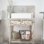 Vintage Bathroom Vanity Farmhouse Sink A Couple Of Faucets Leaf Patterned Tiles Floors Grey Tiles Backsplash A Couple Wall Sconces
