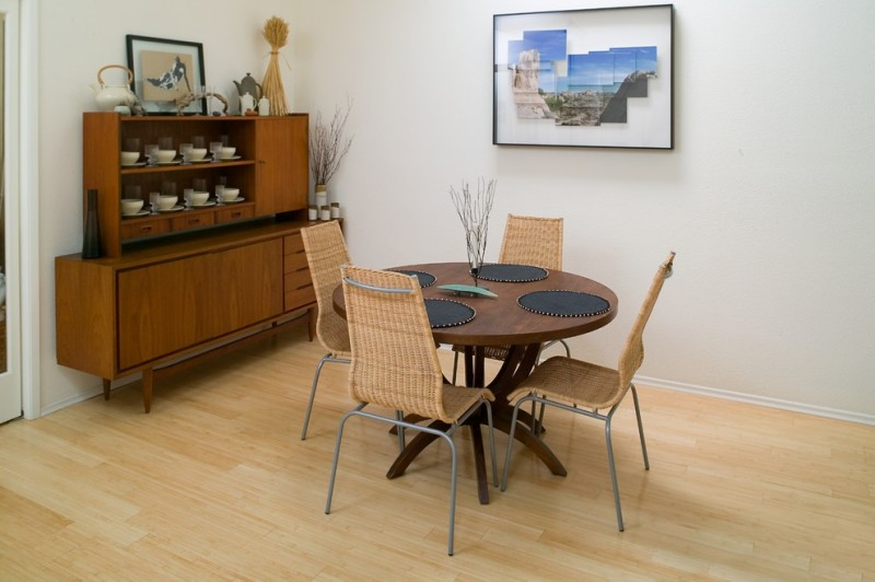 woven dining chairs walnut round top dining table vintage style display cabinet light toned wood floors