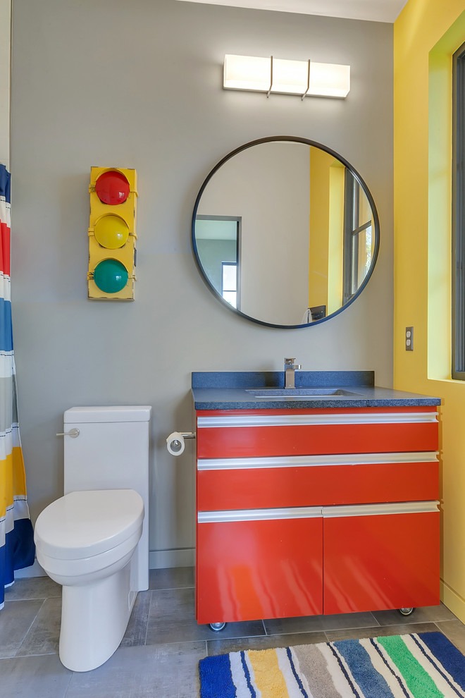 contemporary bathroom playful color bathroom vanity round mirror colorful traffic light decoration white toile concrete tiles floors colorful & stripped mat