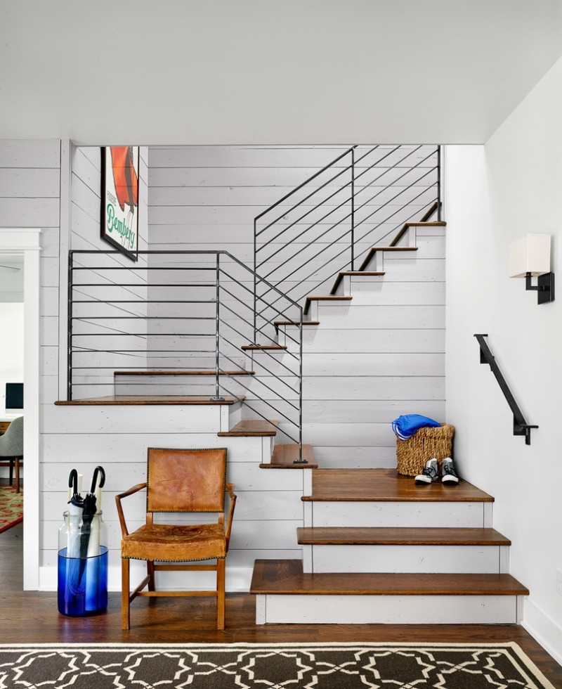farmhouse staircase idea with wood steps and metal railing system vintage leather chair darker wood floors
