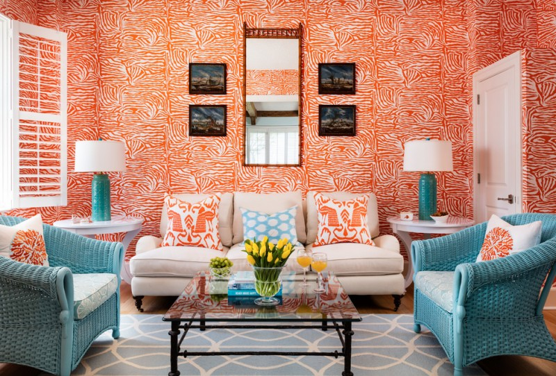 inviting living room vibrant orange wallpaper red framed vertical mirror four series of dark pictures modern white couch stunning blue chairs light blue rug