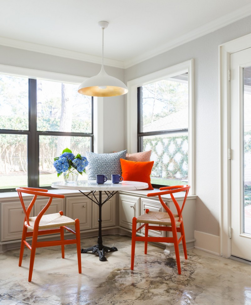 mix traditional scandinavian dining room L shaped bench with under cabinets mid century modern chairs in orange white round top table with black metal stand marble floors
