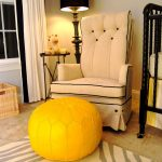 Modern Vintage Nursery Room Higher Back Nursery Chair With Tufted Black Button Accents Yellow Moroccan Leather Pouf Safari Rug