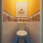 Narrow Contemporary Bathroom Yellow Fire Painting Walls Central White Accent Window Printed Skyscraper Wall Arts White Toilet White Tiles Walls Blue Tiles Floors