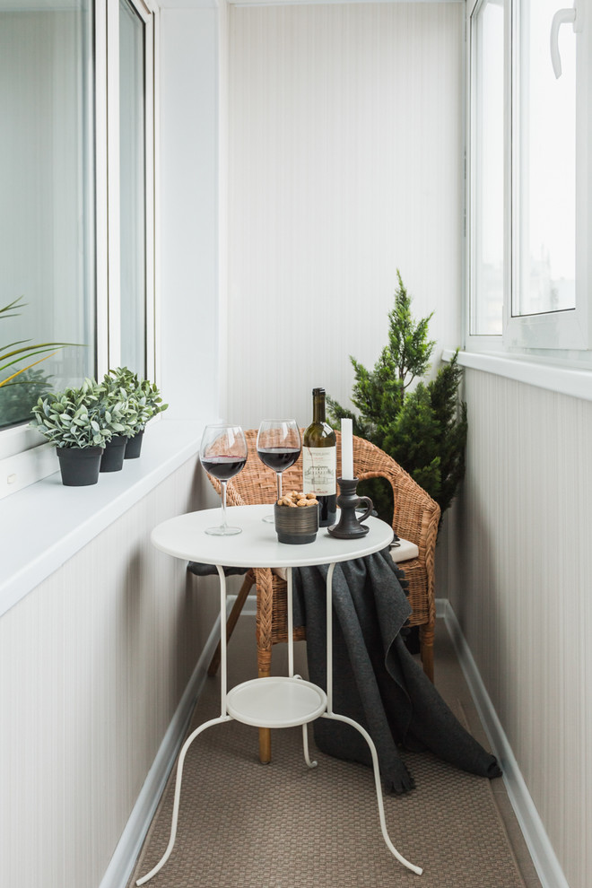 narrow scandinavian balcony idea wood woven armchair white round top table with wider legs