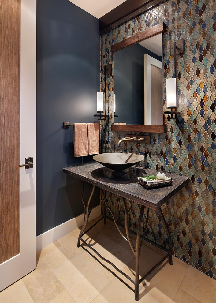 rustic bathroom idea multicolored mosaic tiles walls shabby & dark vanity table with dark vessel sink light limestone tiles floors