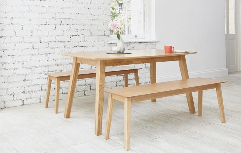 scandinavian dining room light wood dining benches light wood dining table whitewashed wood floors white painted bricks wall