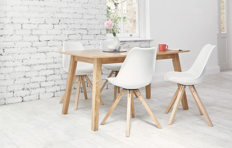 scandinavian dining room white painted bricks walls white wood floors light wood dining table angled wood legs plastic chairs in white