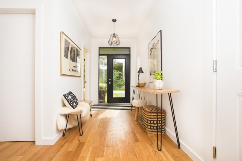 scandinavian entryway medium toned wood floors hairpin legs bench hairpin legs hall console table black front door with centered glass panel and glass side window