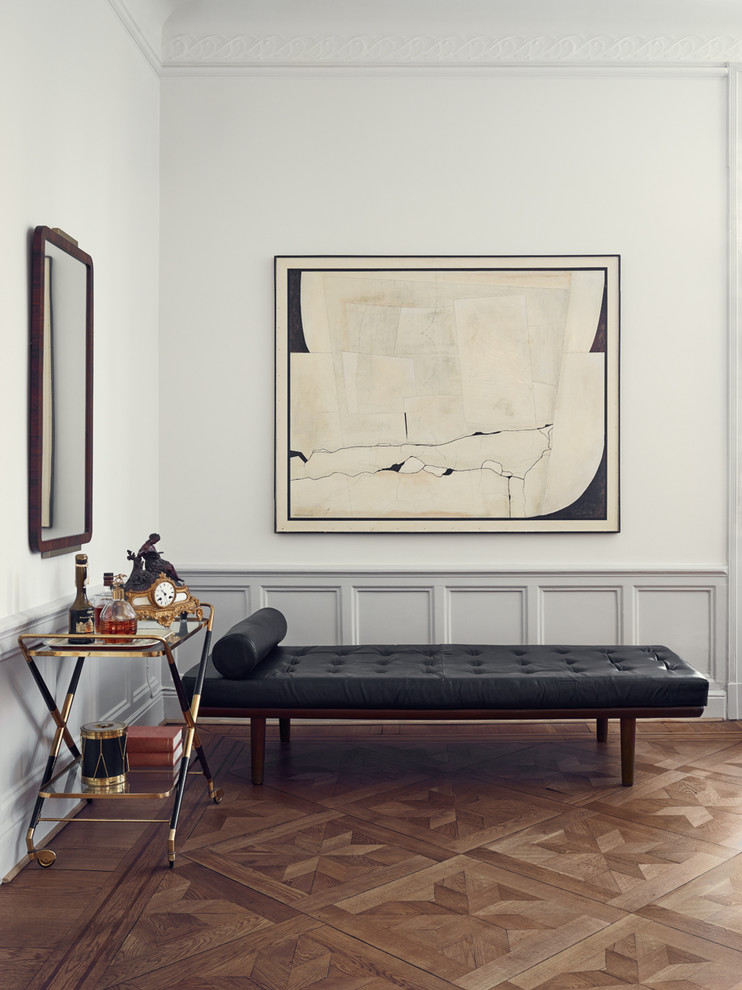 scandinavian home bar X base wine cart with black and gold finishing black tufted leather bench porcelain tiles floors in brown white walls large wall arts