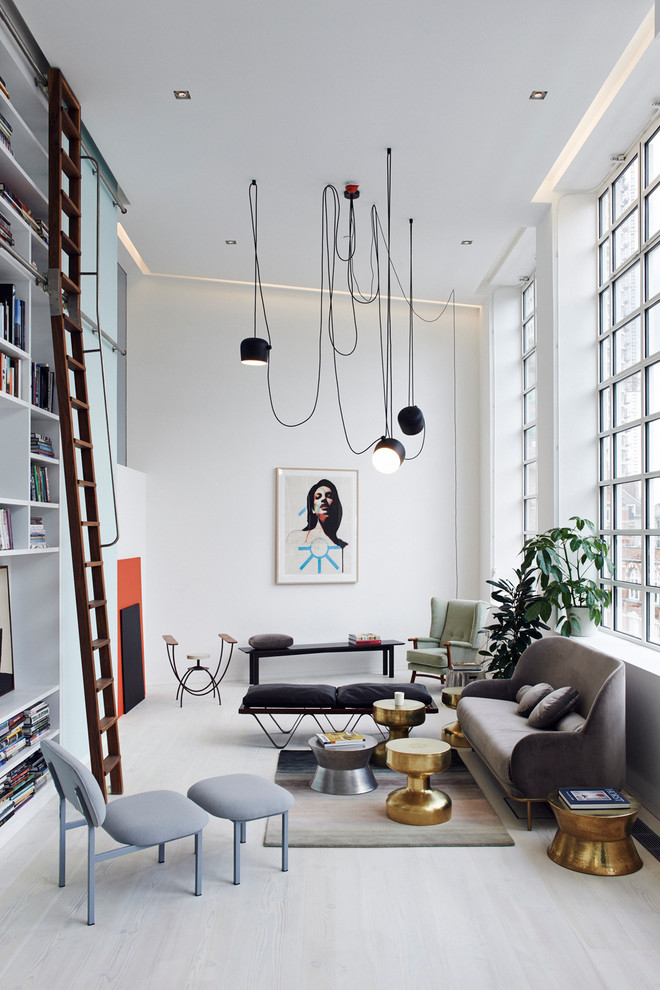 scandinavian living room white interior walls with medium sized pop art pendant lamps with messy wires contemporary furniture set light toned wood floors full height wood ladder full height shelving u