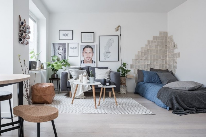 scandinavian open plan family room grey couch modern daybed white fabric area rug white floors wood angled legs center tables