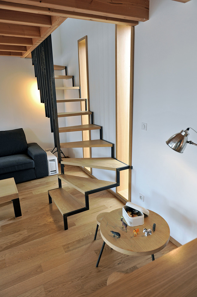 scandinavian staircase with black line accent and railings wood steps