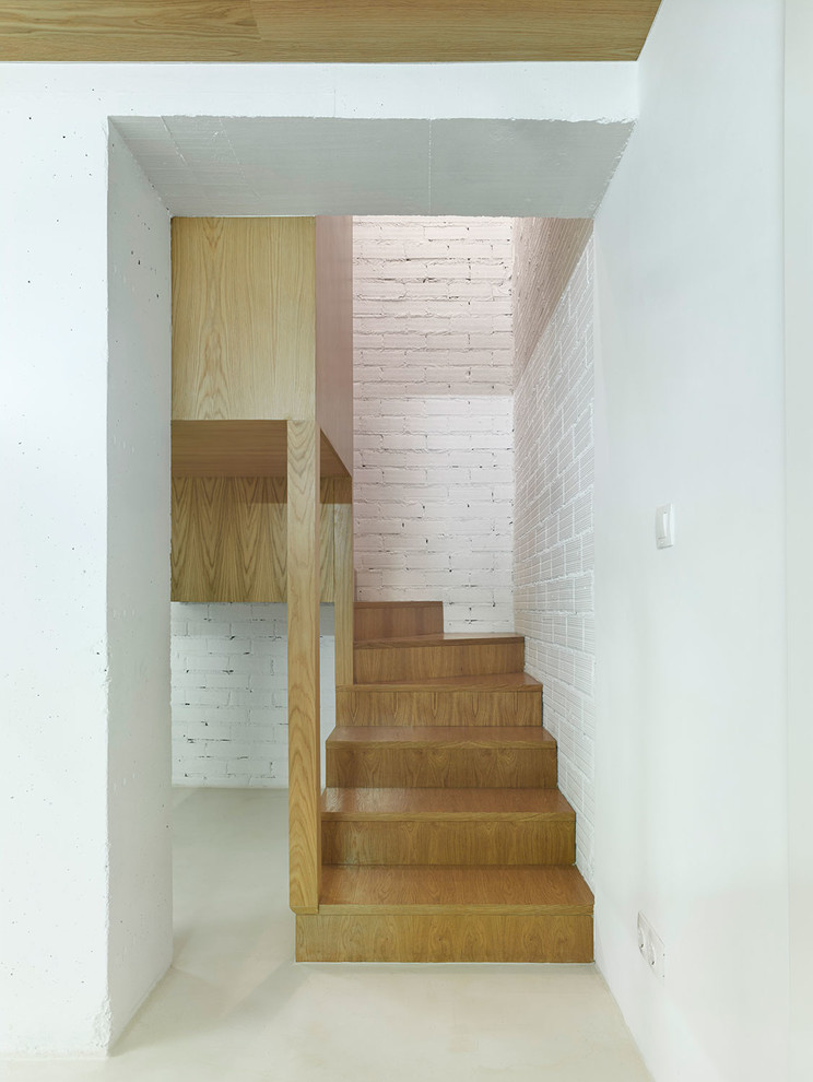 scandinavian wooden staircase idea white painted bricks wall white laminated floors