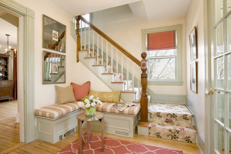 shabby chic corner bench with vintage style covered staircase pink area rug with modern patterns wood railing system medium toned wood board floors