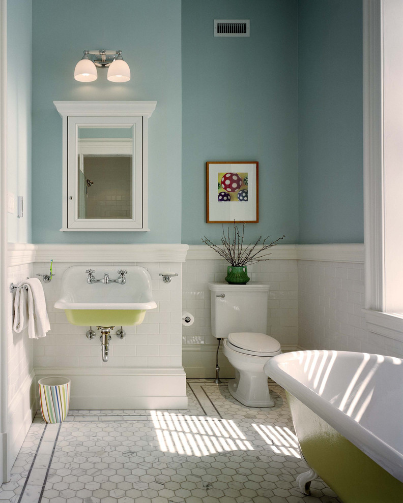small bathroom blue painting walls wall mounted cabinet in white with mirror door medium sized farmhouse sink white baseboard white toilet white tiles floors