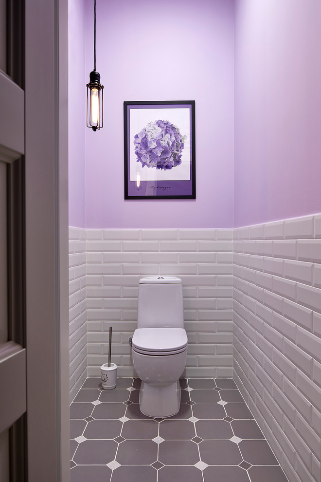 small bathroom purple top walls white brick under walls white toilet mid century modern pendant purple flower wall art